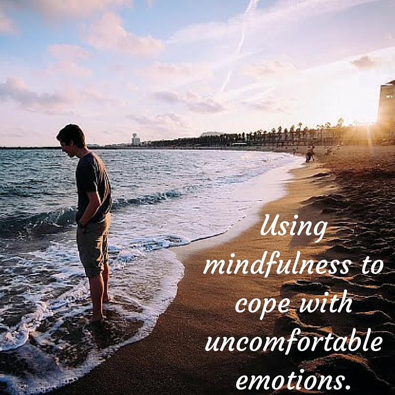 using mindfulness to cope with uncomfortable emotions.